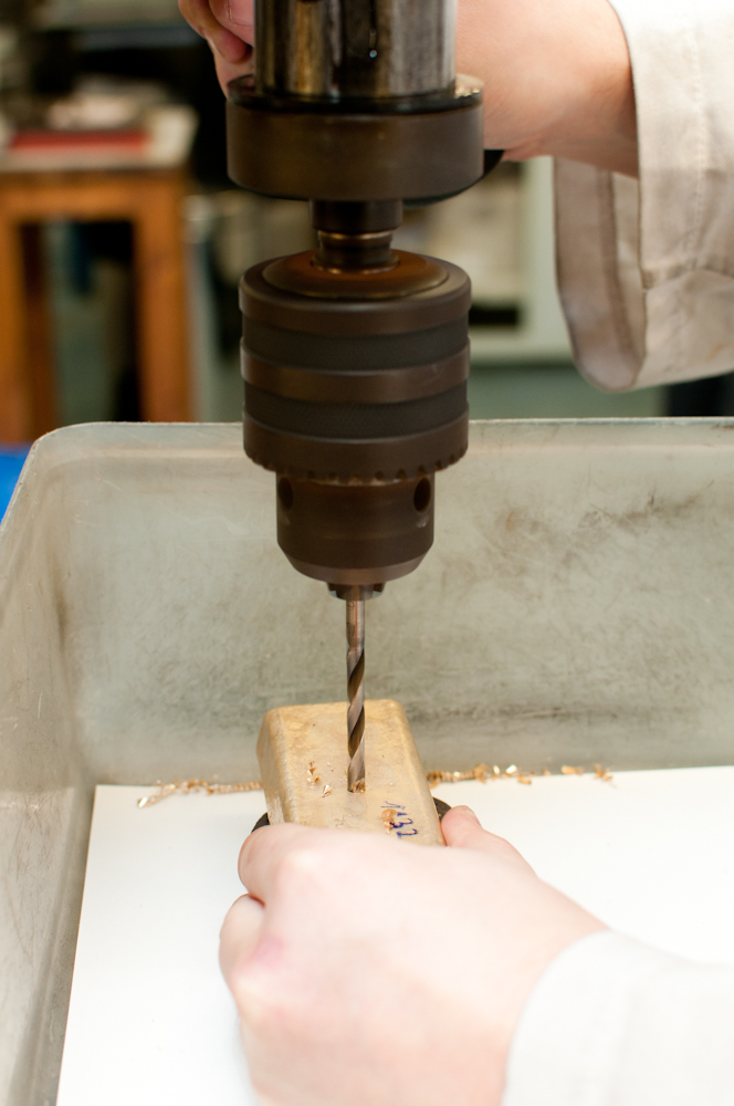 Drilling gold bar to test samples